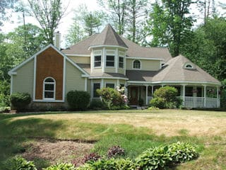 Residential exterior painting by painters gilford NH.