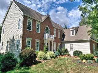 NH Lakes Region Painters residential exterior house painting.